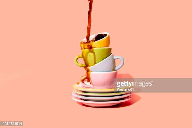 studio shot of coffee pouring on stack of plates and coffee cups - large group of objects stock illustrations