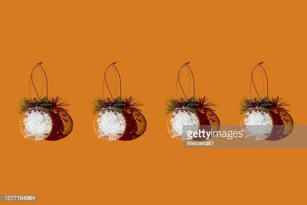 studio shot of row of christmas ornaments - four objects stock illustrations