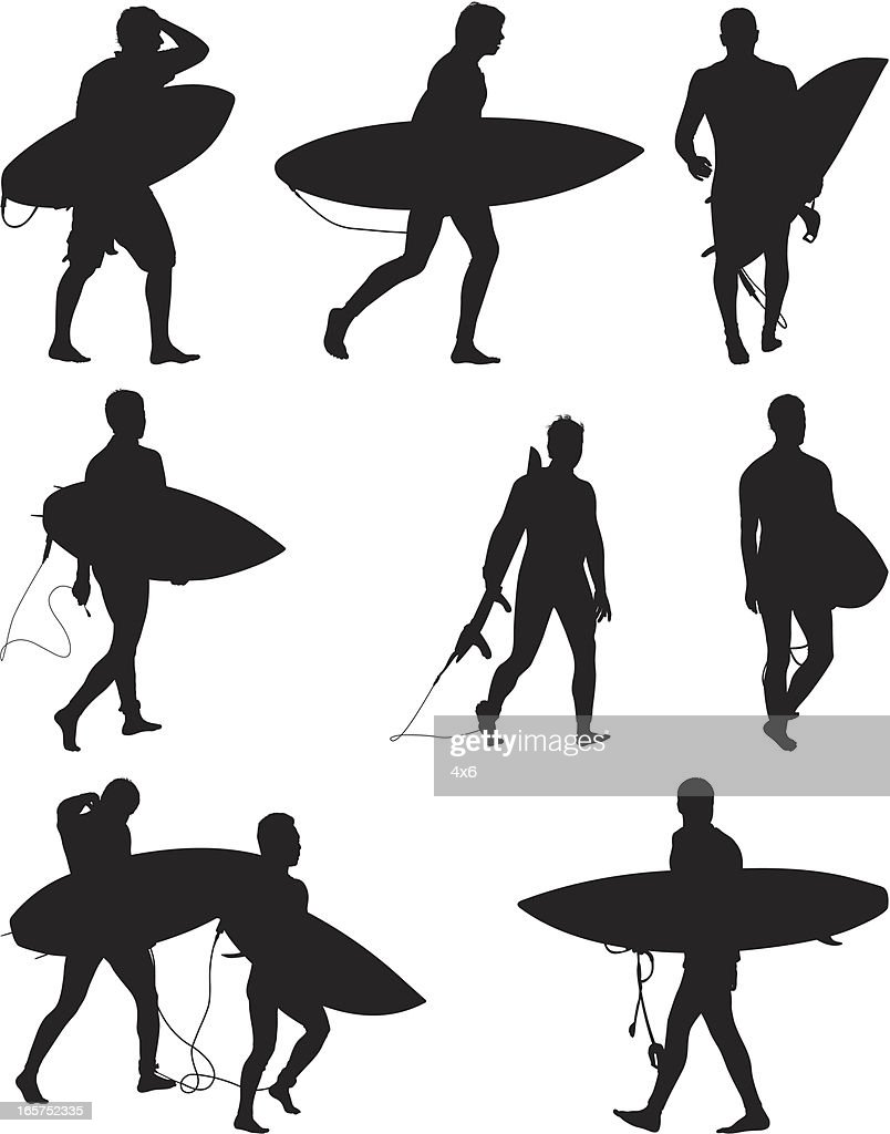 Surfers carrying their surf boards going surfing