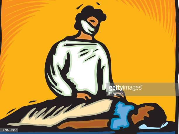 A surgeon preparing a patient for surgery