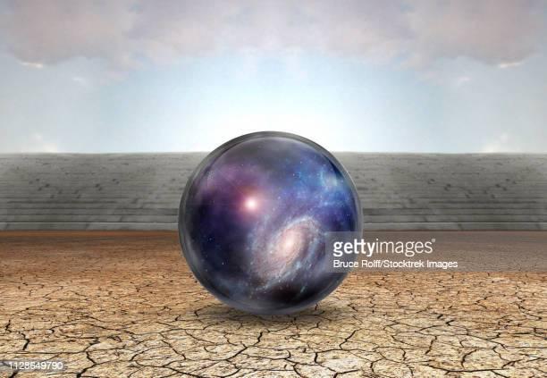 ilustraciones, imágenes clip art, dibujos animados e iconos de stock de surreal digital art. universe in bubble in arid land. - galaxia espiral