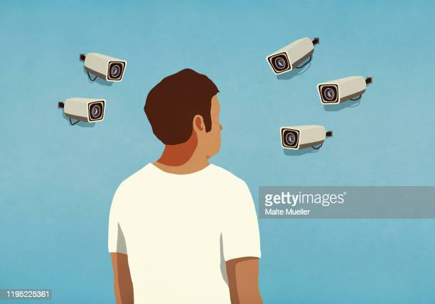 surveillance cameras pointed at man - security camera stock illustrations