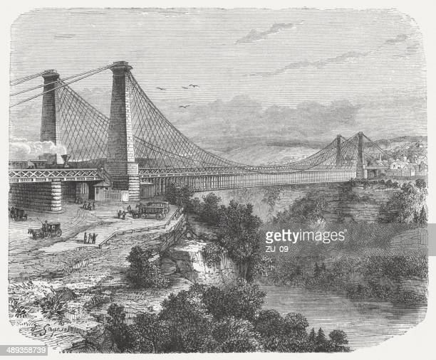 suspension bridge, niagara falls, built 1851-1855, wood engraving, published 1876 - niagara river stock illustrations