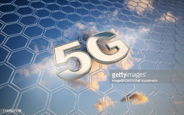 symbol image 5g net in front of blue cloudy sky with net pattern, germany - central europe stock illustrations, clip art, cartoons, & icons