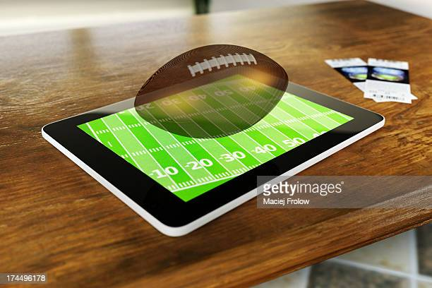 Tablet and american football ball hologram