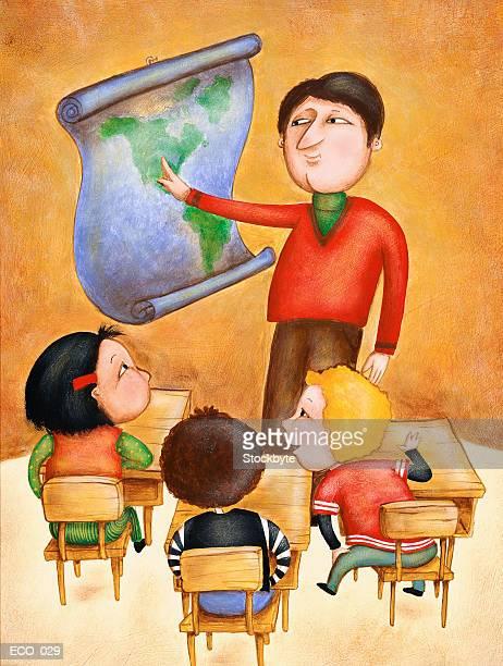 Teacher pointing to map, three children in desks in front of him