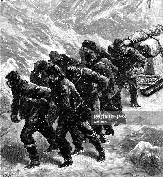 Team of men pulling a sledge through ice and snow