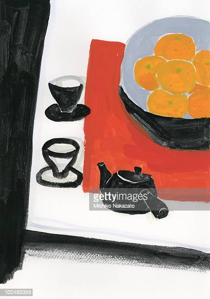 Teapot and tea cup with food on table