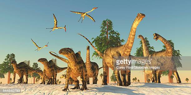 Tenontosaurus and Argentinosaurus dinosaurs migrating in search of water.