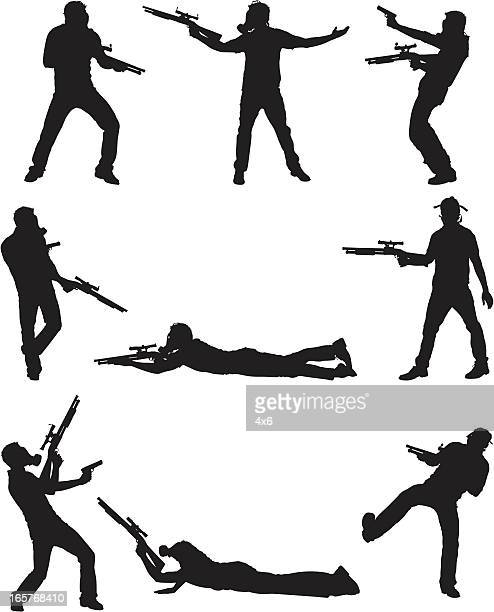 Terrorist with guns wearing gas mask