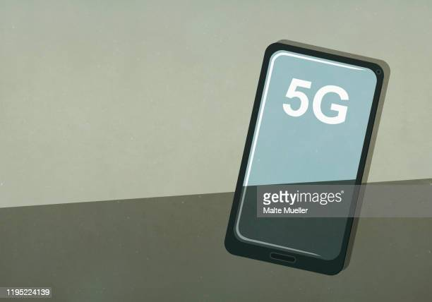 5g text on smart phone screen - transparent stock illustrations