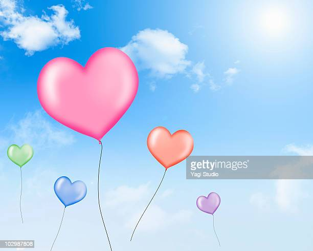 The balloon of a heart type to pass in the sky