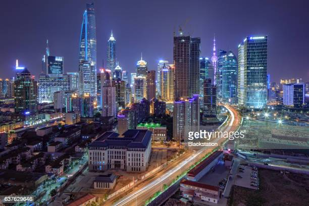 the busy lujiazui fianancail and trade zone - overpass road stock illustrations