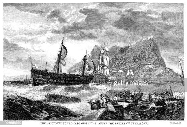 the damaged hms victory being towed into gibraltar after the battle of trafalgar, 1805 - admiral nelson stock illustrations