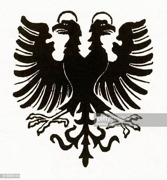 De dubbelkoppige adelaar Nimbus christelijke symboliek gravure