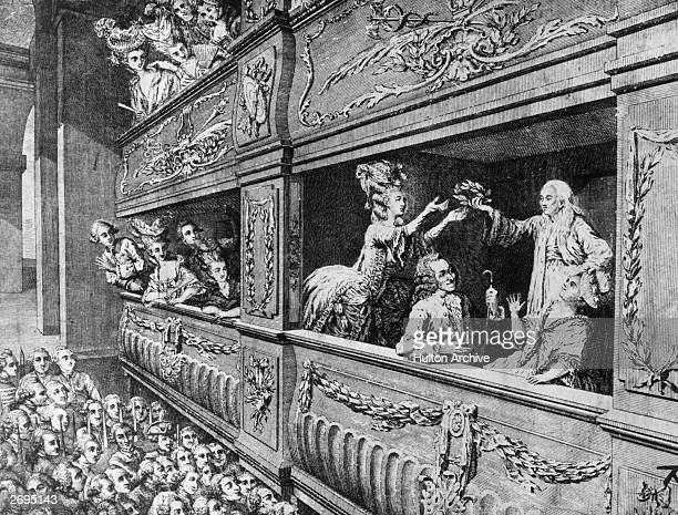 The French philosopher and playwright Voltaire being honoured during a showing of his last play 'Irene'