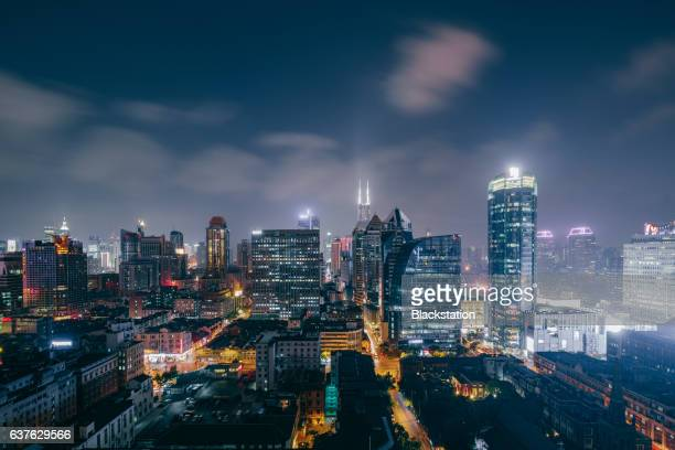 the hustle and bustle of city night life - tall high stock illustrations