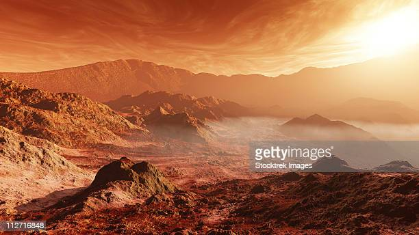 The Martian sun sets over the high walls of Mojave Crater.