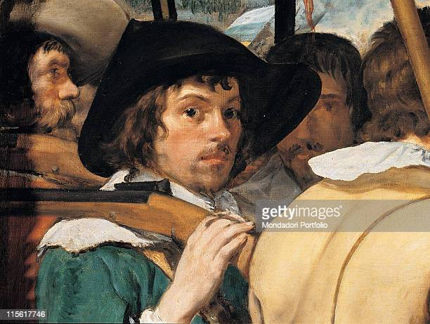 Spain. Madrid. Madrid. Prado National Museum. Detail of man with rifle slung over his shoulder. Wide-brimmed hat collar white black beige yellow...