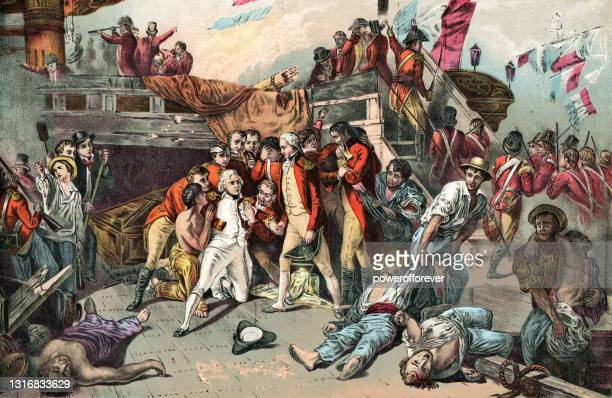 the wounding of vice-admiral horatio nelson at the battle of trafalgar - 19th century - admiral nelson stock illustrations