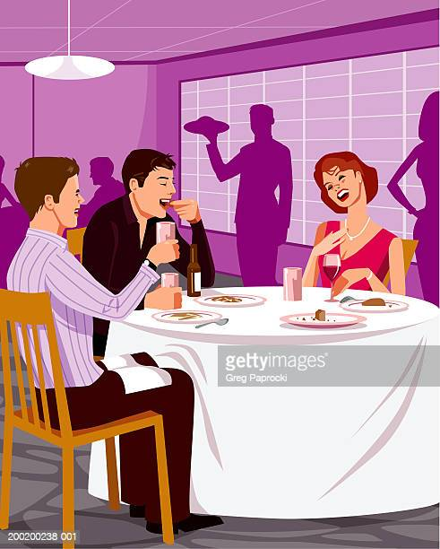 Three adults eating meal in restaurant, smiling