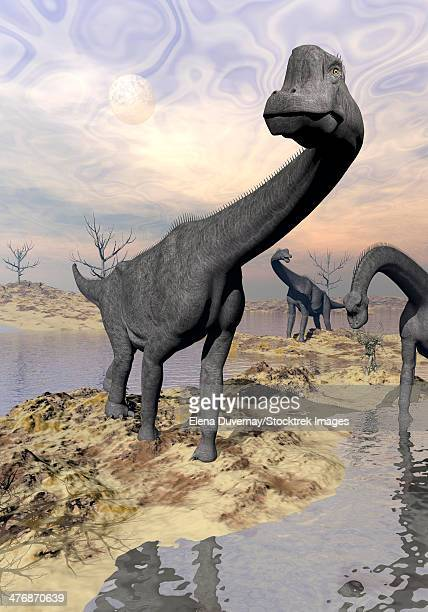 Three Brachiosaurus dinosaurs near water with reflection by sunset and full moon.