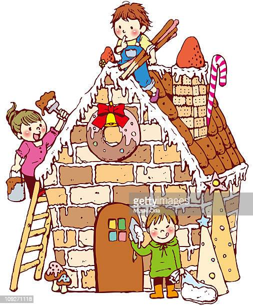Three children making a gingerbread house