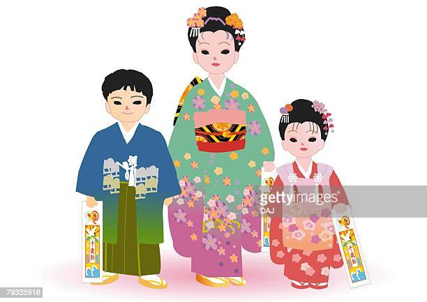 three children standing and holding candy bag in japanese style clothing, front view, japan - only japanese stock illustrations, clip art, cartoons, & icons