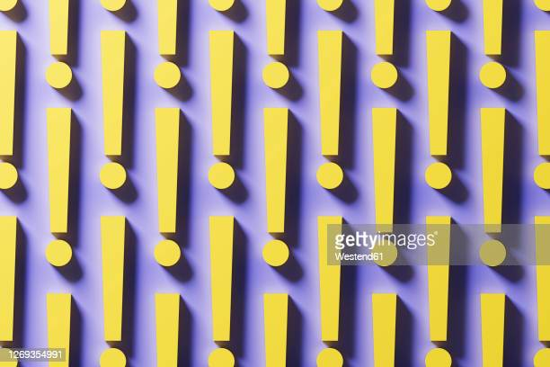 three dimensional pattern of rows of yellow exclamation points - pattern stock illustrations