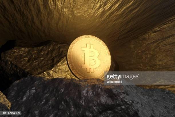 three dimensional render of bitcoin shining inside mine - 鉱業点のイラスト素材/クリップアート素材/マンガ素材/アイコン素材