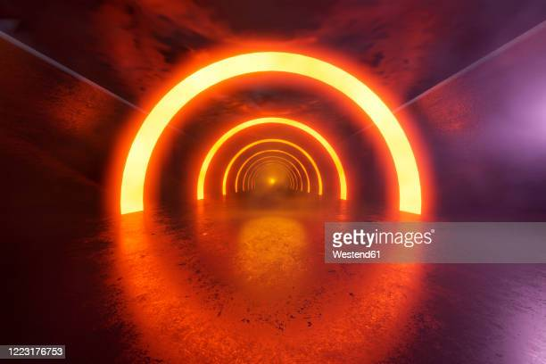 three dimensional render of futuristic corridor illuminated by orange glowing arches - light at the end of the tunnel stock illustrations