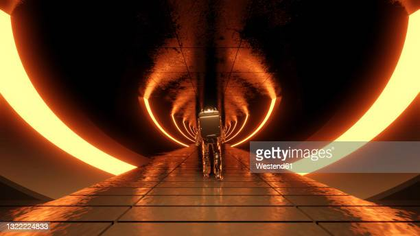 three dimensional render of lone astronaut exploring futuristic corridor illuminated by orange glowing arches - exploration stock illustrations