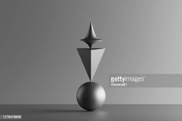 three dimensional render of metallic top spinning on top of geometric pyramid and sphere - small group of objects stock illustrations