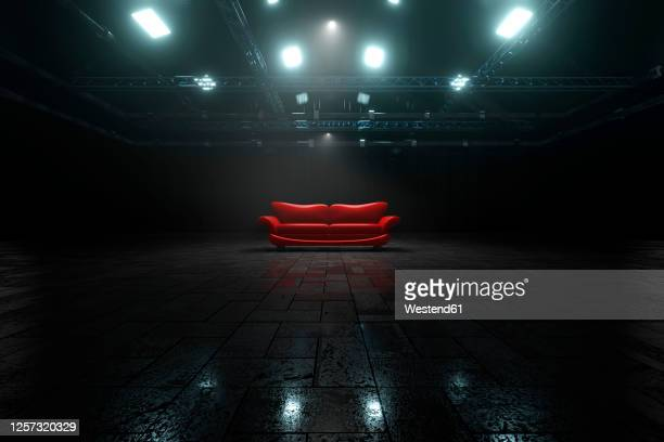 three dimensional render of red sofa inside dark warehouse - no people stock illustrations