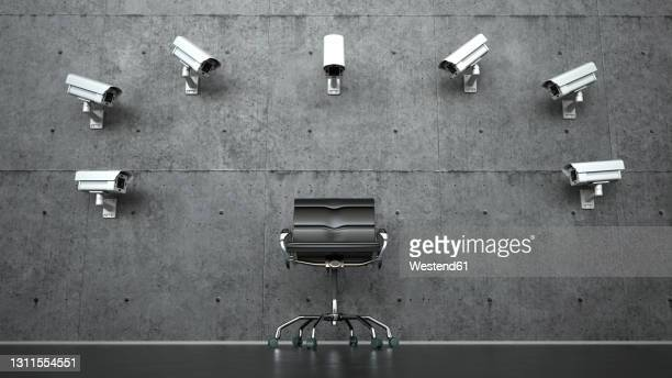 three dimensional render of security cameras pointed at empty office chair - business security camera stock illustrations