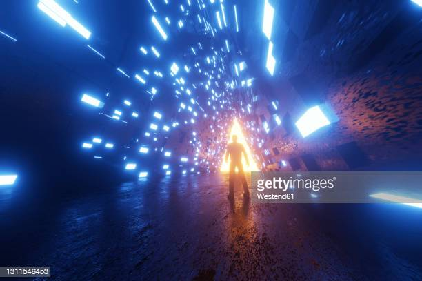 three dimensional render of silhouette of man standing in front of triangle shaped portal glowing at end of futuristic corridor - full length stock illustrations