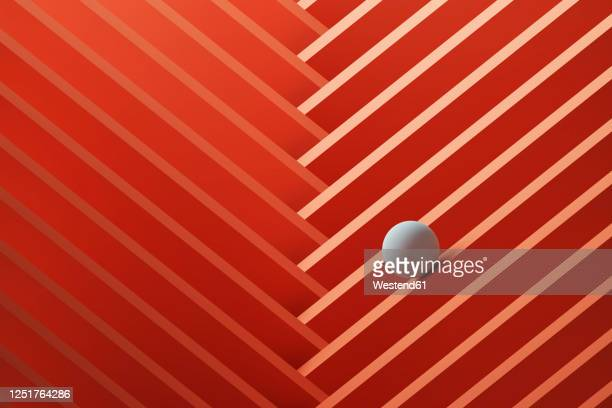 three dimensional render of small white sphere rolling over geometric pattern - in a row stock illustrations