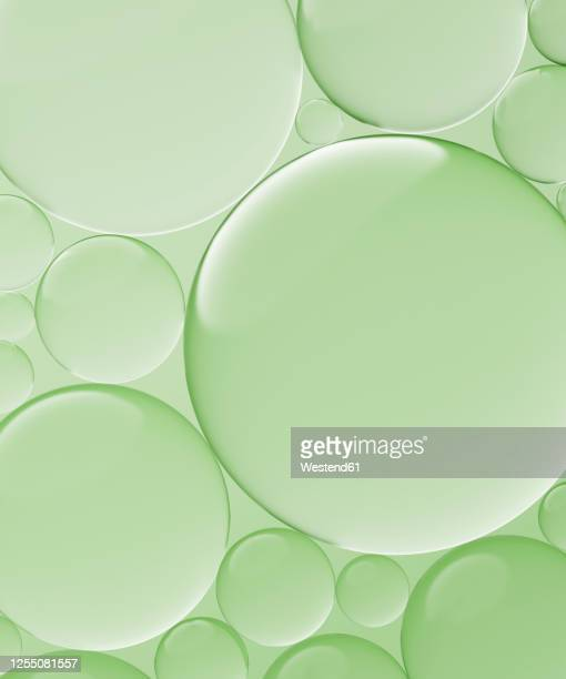 three dimensional render of transparent glass spheres against green background - transparent stock illustrations