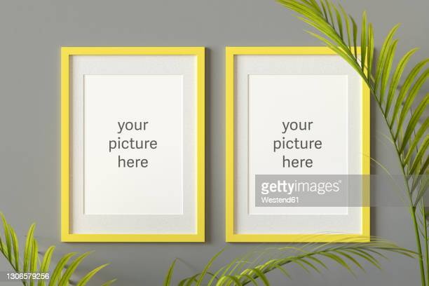 three dimensional render of two picture frames with placeholder text hanging on gray wall - opportunity stock illustrations