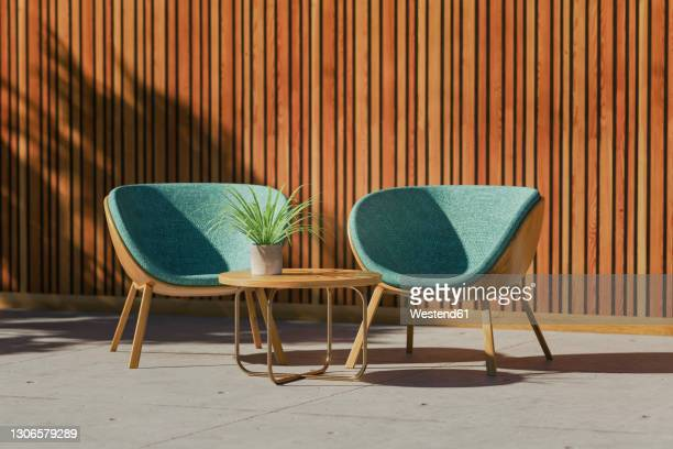 stockillustraties, clipart, cartoons en iconen met three dimensional render of two retro styled chairs, coffee table and potted plant standing on balcony - buitenopname