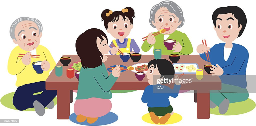Three Generation Family Eating And Sitting At Table