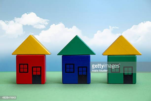 three houses made from toy blocks - facade stock illustrations