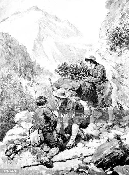 Three hunters with guns lying on a rock waiting for animals