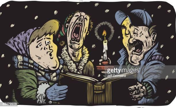 Three people singing Christmas carols