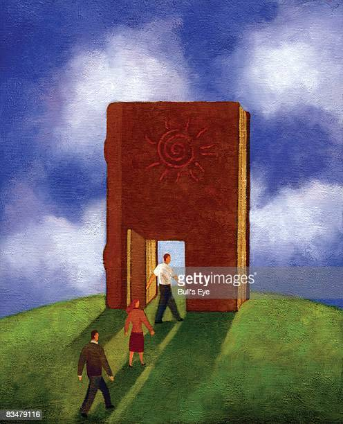 Three people walking through a doorway in a giant book