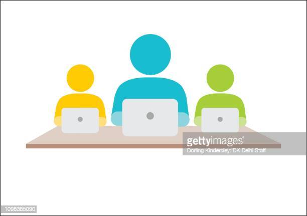 Three people with laptops