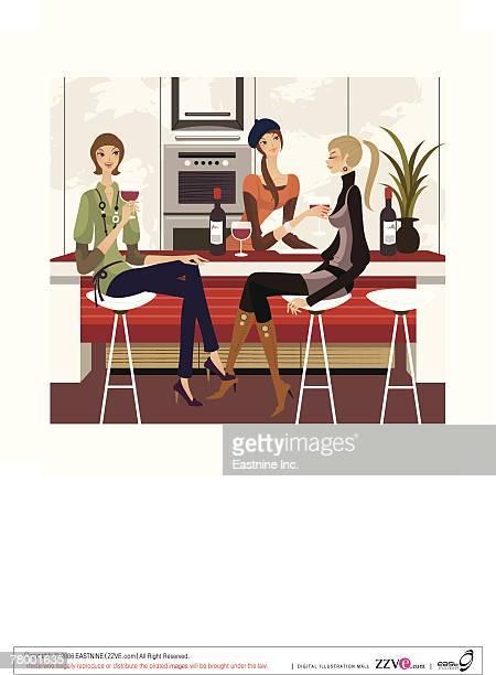 Three women holding glasses of wine
