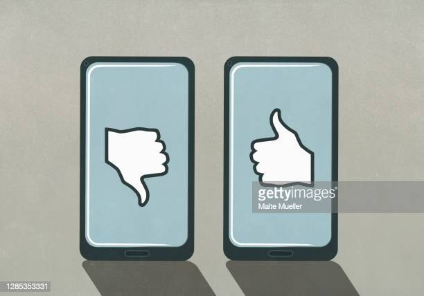 thumbs up and thumbs down symbols on smart phone screens - like button stock illustrations