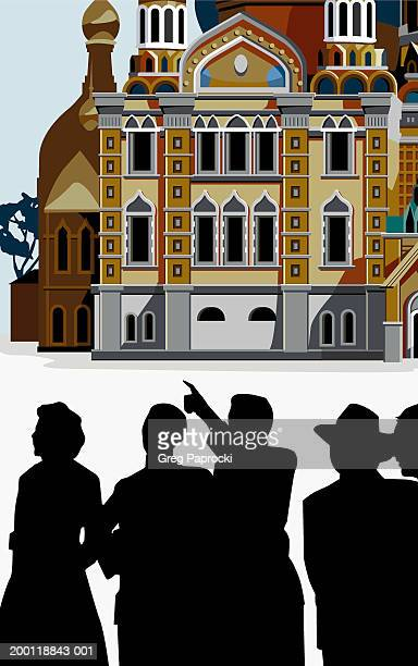 Tourists viewing ancient building, silhouettes