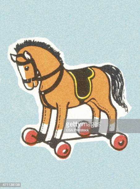 toy horse on wheels - pony stock illustrations, clip art, cartoons, & icons